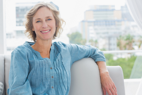 Dental Implant Solutions Smiling Woman in Chair